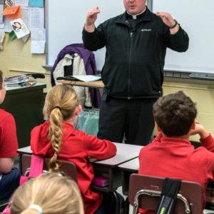 Fr. Matt Alcombright teaching at St. Michael's